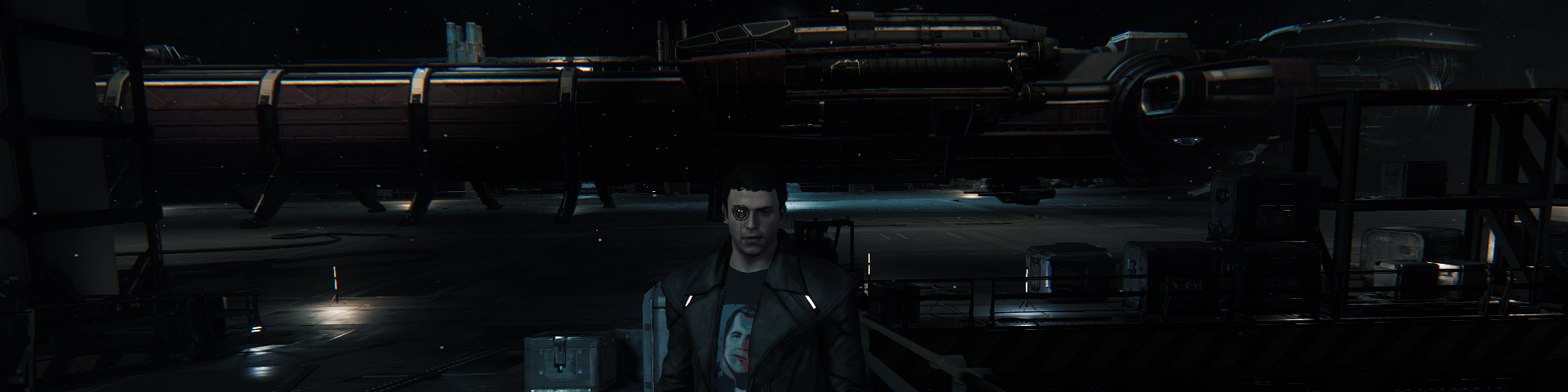 A man standing in front of one of the tramp steamers of space; landed in an in-ground hangar.